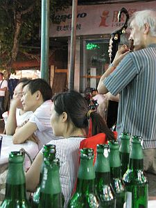 Musicians boring the guy on the next table while we have another beer